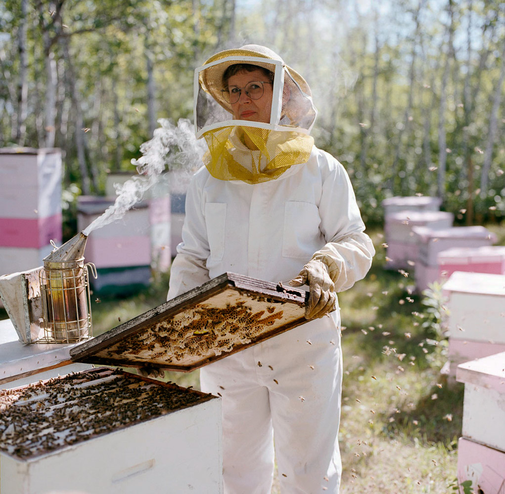 Beekeeper by winnipeg editorial photographer