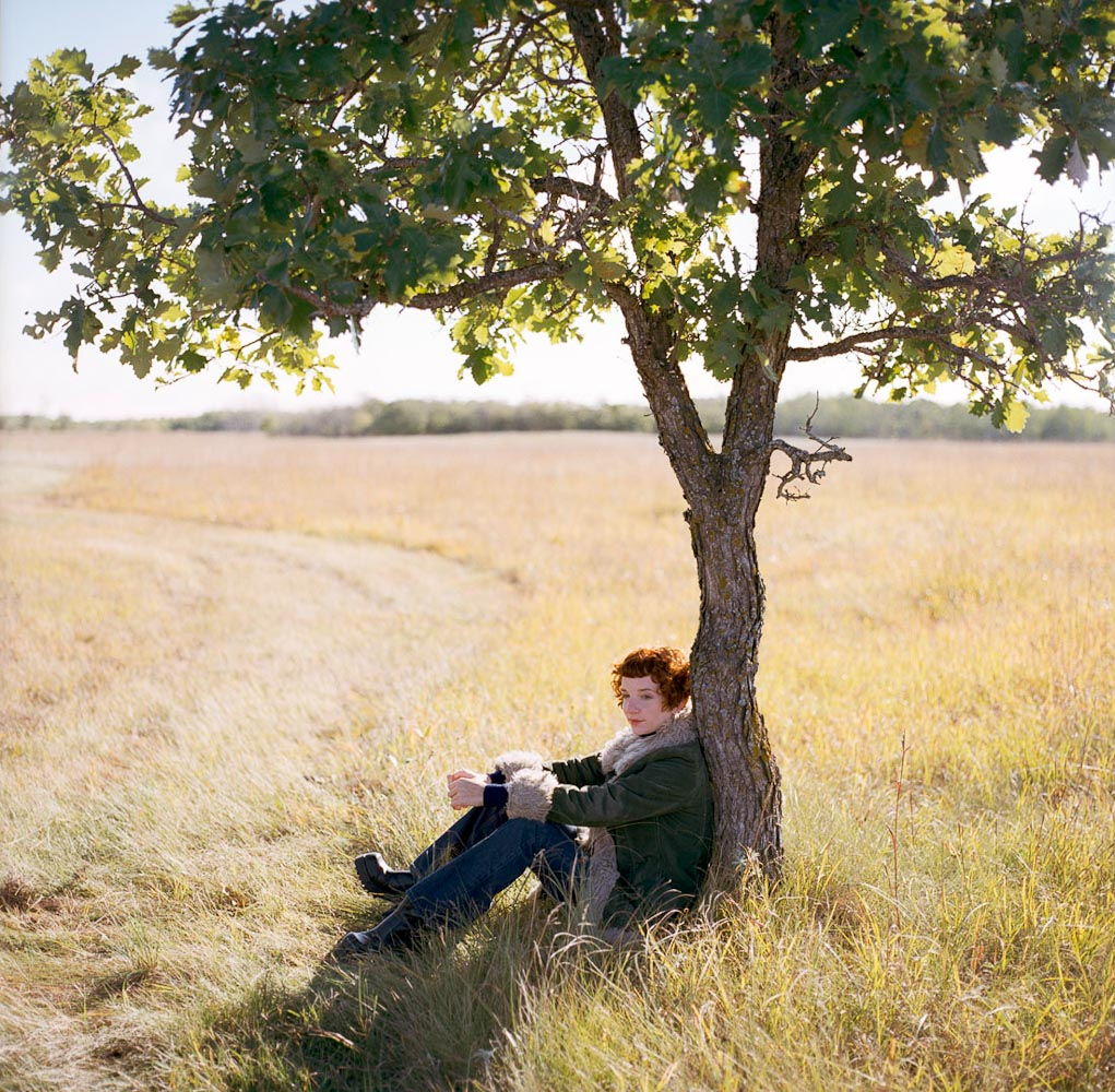 Woman under tree by winnipeg editorial photographer