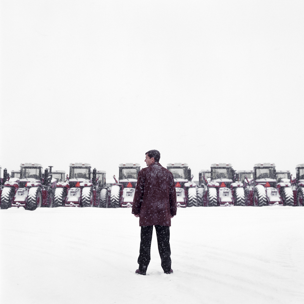 Craig Engel with tractors by winnipeg editorial photographer