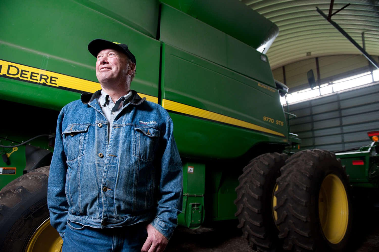 John Deere farmer by winnipeg commercial photographer