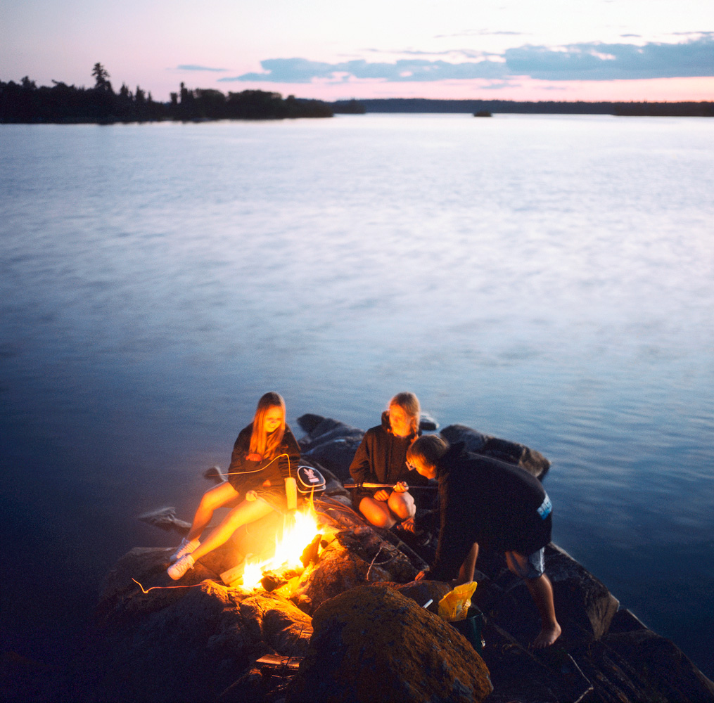 Lakeside bonfire by Winnipeg editorial photographer
