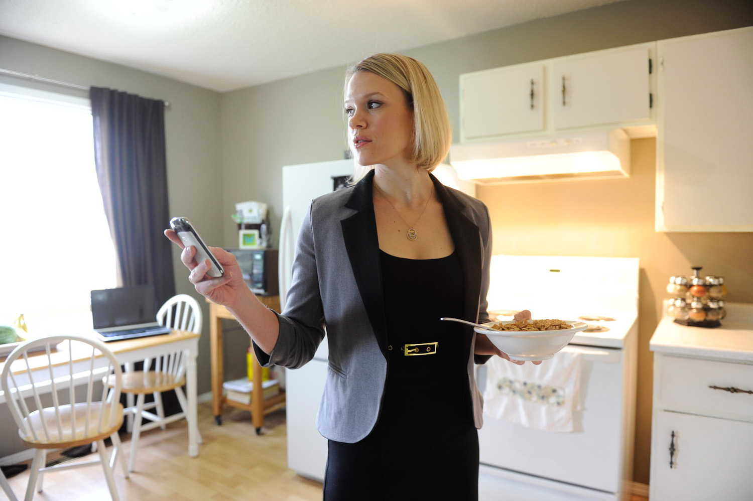 Businesswoman at home by winnipeg editorial photographer