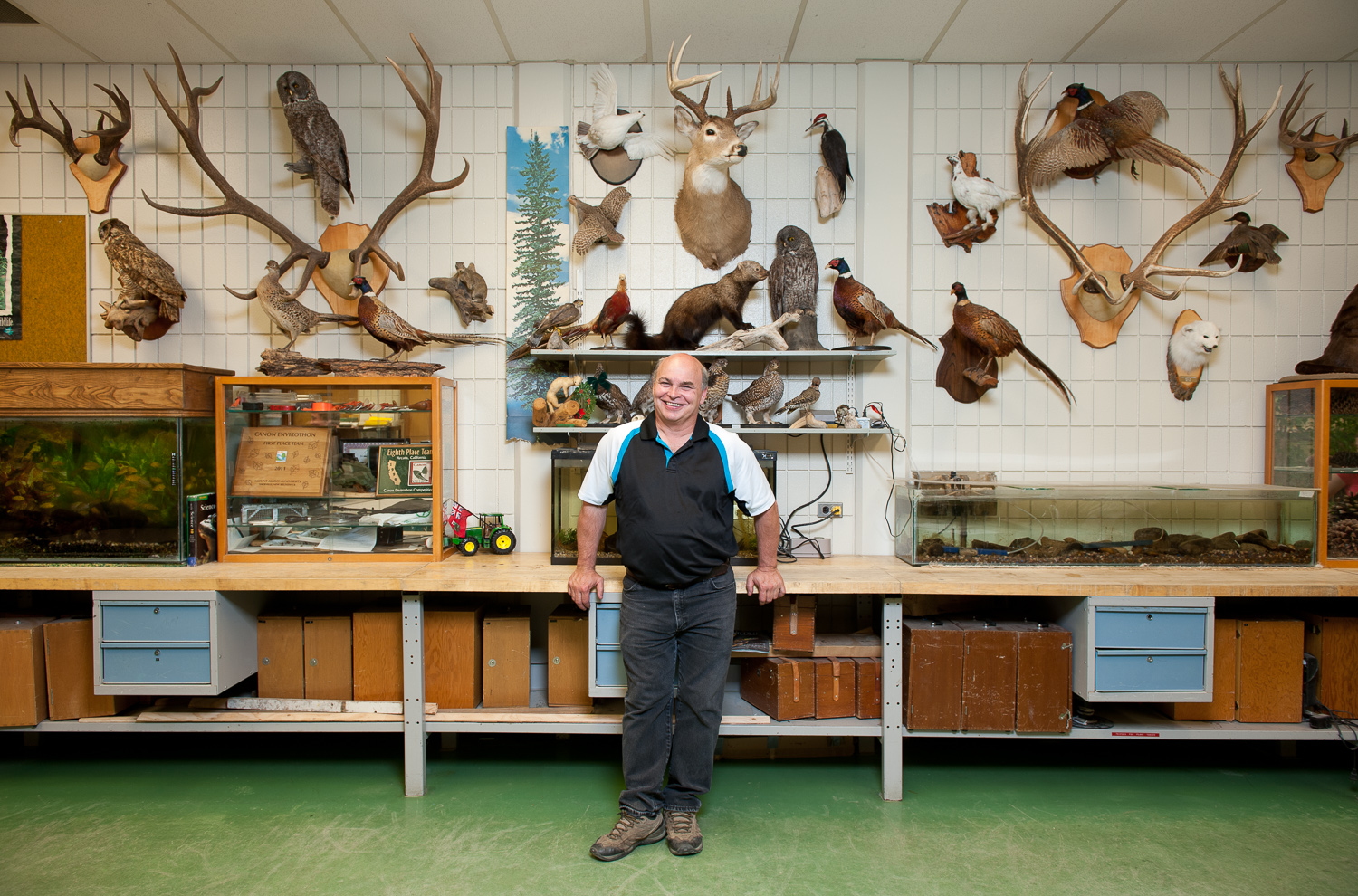 Man with animal head wall plaques by winnipeg editorial photographer