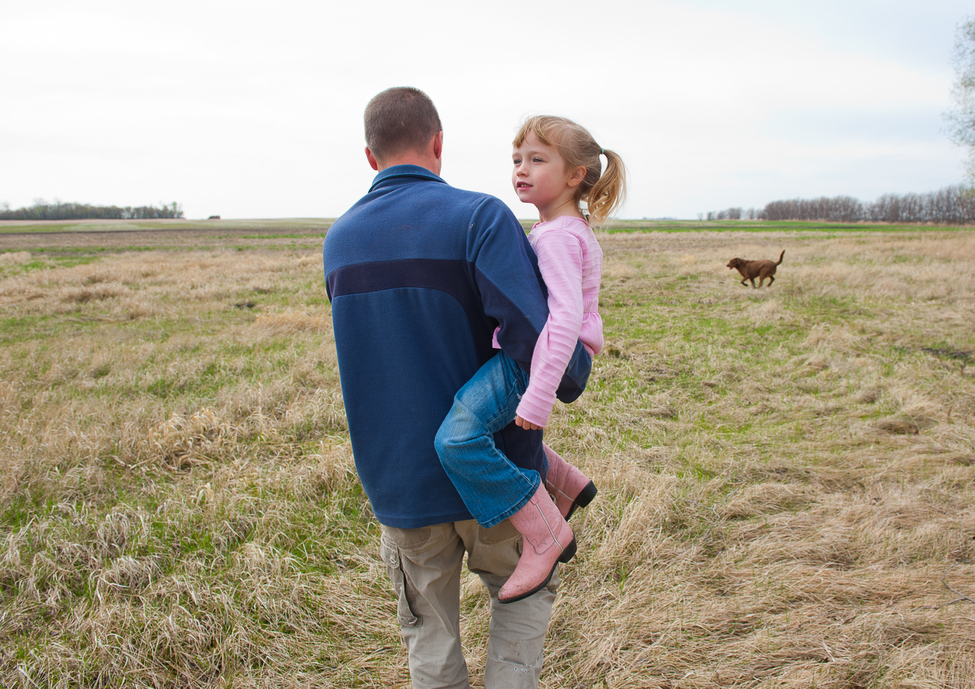 Farmer with daughter by Winnipeg commercial photographer