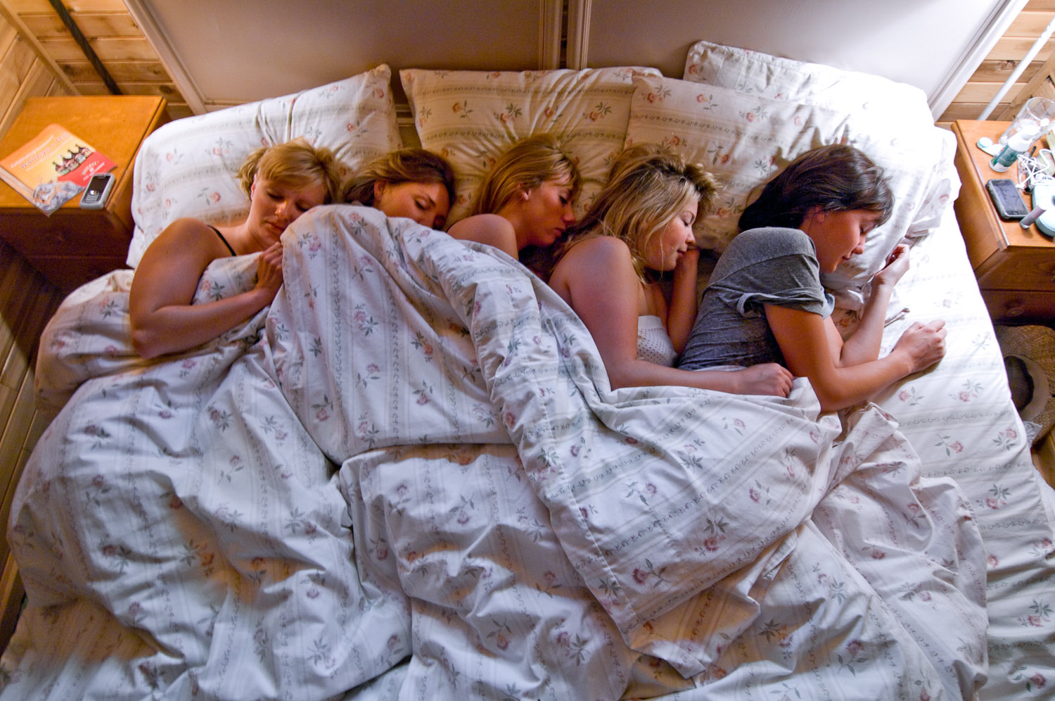 Five girls in bed by Winnipeg editorial photographer