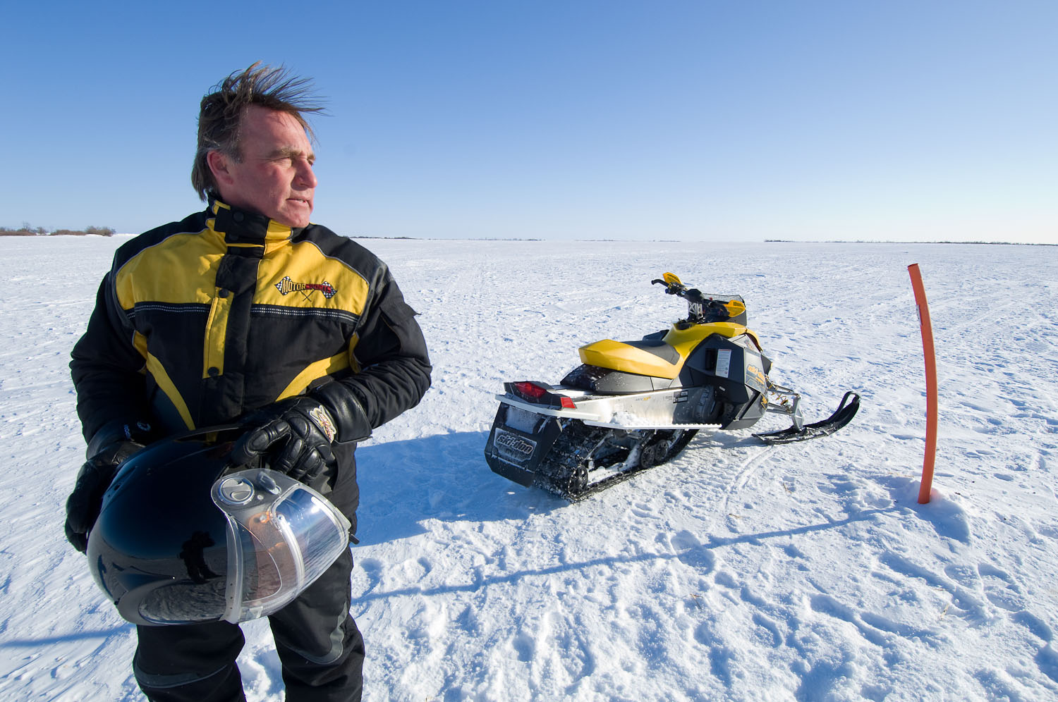 Snowmobiler  by Winnipeg editorial photographer