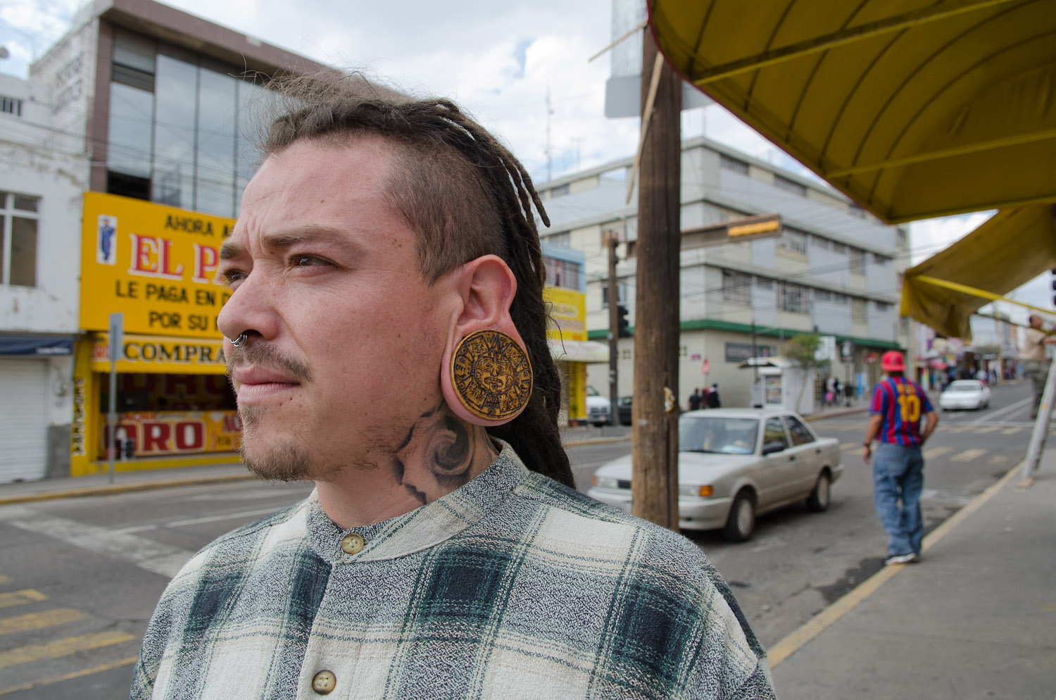 Large ear piercing by Winnipeg travel photographer