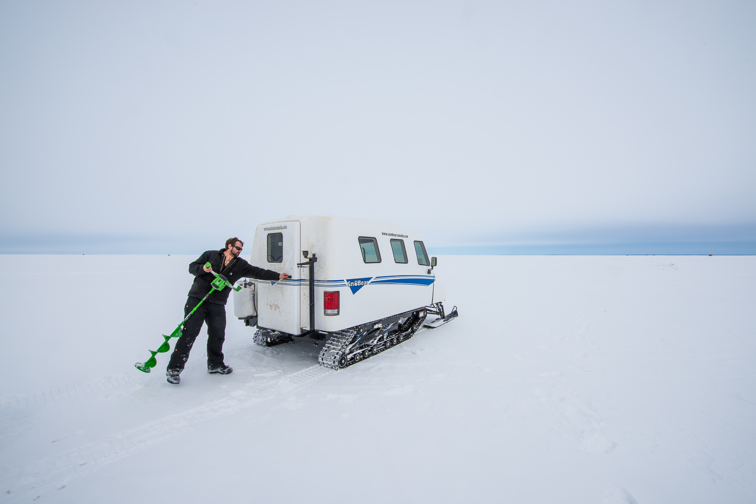 Ice fishing by Winnipeg commercial photographer